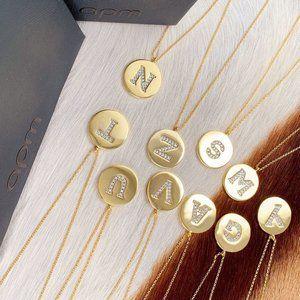 Apm Monaco Gold Letter Coin Necklace